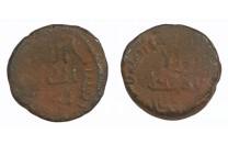 فلس أموي بدون مدينة ضرب 97 هـ سليمان بن عبدالملك - 1734 -